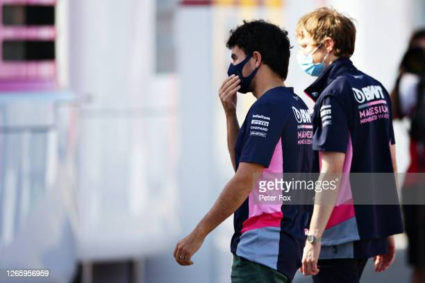 Sergio Perez of Mexico and Racing Point walks in the Paddock for the first time since testing positive for COVID-19 and missing the previous two...