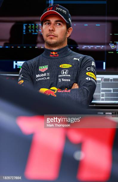 Sergio Perez of Mexico and Red Bull Racing looks on in the garage ahead of the F1 Grand Prix of Styria at Red Bull Ring on June 27, 2021 in...