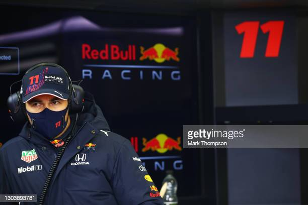 Sergio Perez of Mexico and Red Bull Racing looks on in the garage during the Red Bull Racing Filming Day at Silverstone on February 24, 2021 in...