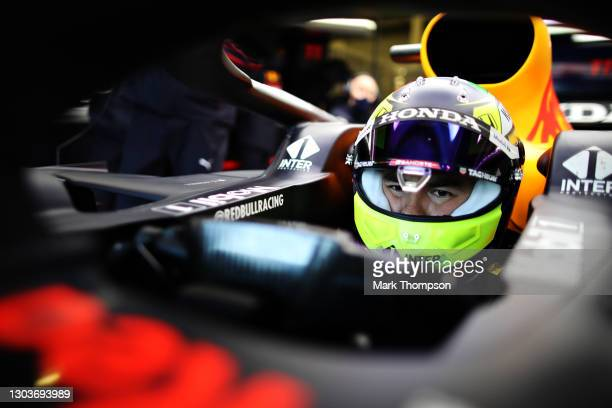 Sergio Perez of Mexico and Red Bull Racing prepares to drive in the garage during the Red Bull Racing filming day at Silverstone on February 22, 2021...