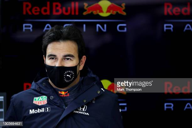 Sergio Perez of Mexico and Red Bull Racing prepares to drive in the garage during the Red Bull Racing filming day at Silverstone on February 23, 2021...