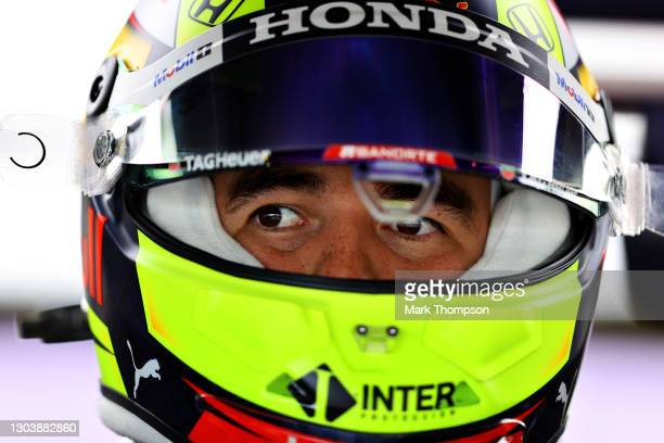 Sergio Perez of Mexico and Red Bull Racing prepares to drive in the garage during the Red Bull Racing Filming Day at Silverstone on February 24, 2021...
