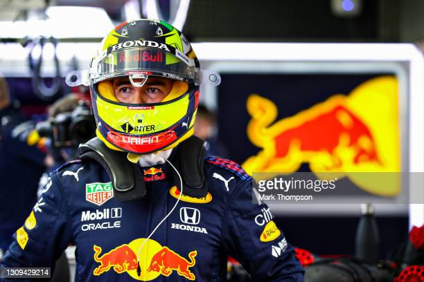 Sergio Perez of Mexico and Red Bull Racing prepares to drive in the garage during qualifying ahead of the F1 Grand Prix of Bahrain at Bahrain...