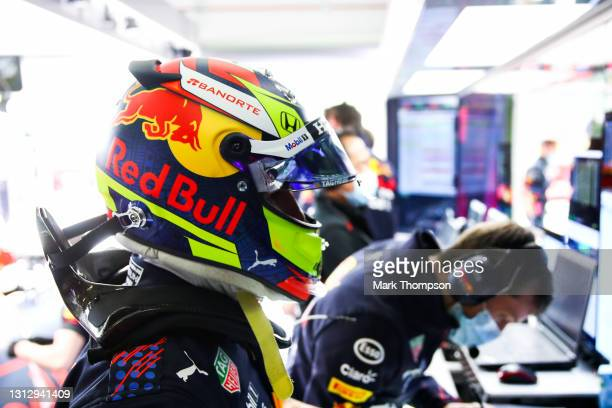 Sergio Perez of Mexico and Red Bull Racing prepares to drive in the garage during final practice ahead of the F1 Grand Prix of Emilia Romagna at...