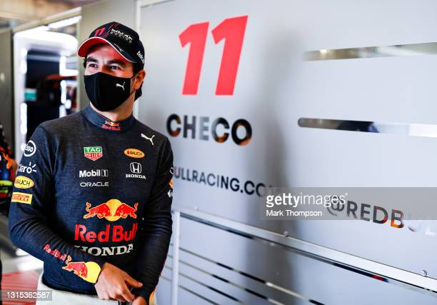 Sergio Perez of Mexico and Red Bull Racing prepares to drive in the garage during practice ahead of the F1 Grand Prix of Portugal at Autodromo...