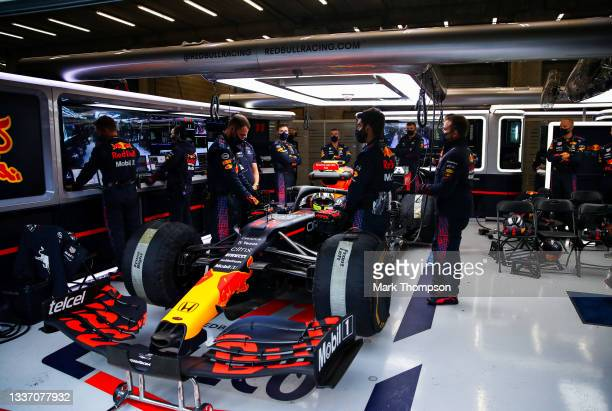 Sergio Perez of Mexico and Red Bull Racing prepares to leave the garage for the restart during the F1 Grand Prix of Belgium at Circuit de...