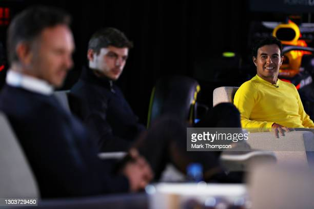Sergio Perez of Mexico and Red Bull Racing talks during An Evening with Red Bull Racing at Red Bull Racing Factory on February 23, 2021 in Milton...