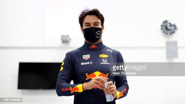 Sergio Perez of Mexico and Red Bull Racing walks in the engineering bays at Red Bull Racing Factory on January 12, 2021 in Milton Keynes, England.