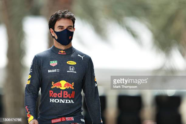 Sergio Perez of Mexico and Red Bull Racing walks in the Paddock during previews ahead of Formula 1 Testing at Bahrain International Circuit on March...