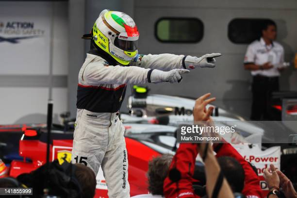 Sergio Perez of Mexico and Sauber F1 celebrates in parc ferme after finishing second during the Malaysian Formula One Grand Prix at the Sepang...