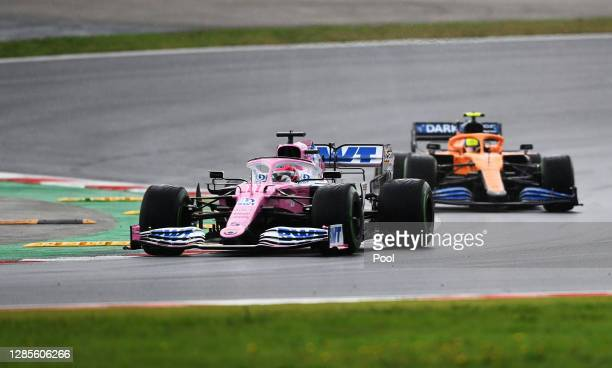 Sergio Perez of Mexico driving the Racing Point RP20 Mercedes leads Lando Norris of Great Britain driving the McLaren F1 Team MCL35 Renault on track...