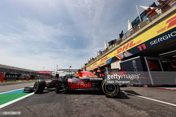 Sergio Perez of Mexico driving the Red Bull Racing RB16B Honda leaves the garage during practice ahead of the F1 Grand Prix of France at Circuit Paul...