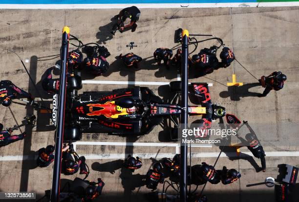 Sergio Perez of Mexico driving the Red Bull Racing RB16B Honda makes a pitstop during the F1 Grand Prix of Styria at Red Bull Ring on June 27, 2021...