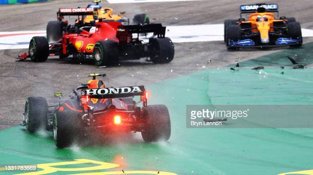 Sergio Perez of Mexico driving the Red Bull Racing RB16B Honda runs wide at the start as cars tangle ahead of him during the F1 Grand Prix of Hungary...