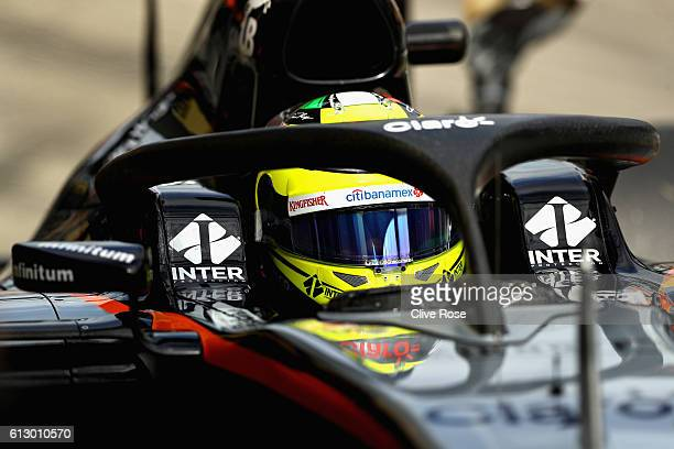 Sergio Perez of Mexico driving the Sahara Force India F1 Team VJM09 Mercedes PU106C Hybrid turbo fitted with the halo device in the Pitlane during...