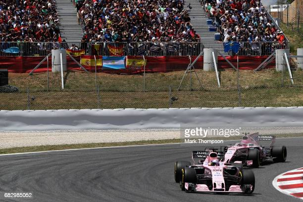 Sergio Perez of Mexico driving the Sahara Force India F1 Team VJM10 leads Esteban Ocon of France driving the Sahara Force India F1 Team VJM10 during...