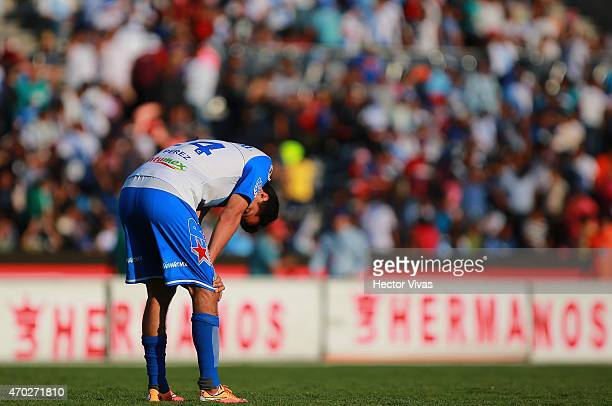 Sergio Perez of Puebla reacts during a match between Puebla and Atlas as part of 14th round Clausura 2015 Liga MX at Olimpico Universitario BUAP...