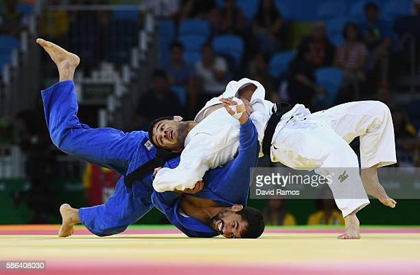 Sergio Pessoa of Canada competes against Amiran Papinashvili of Georgia in the Men's -60 kg Judo on Day 1 of the Rio 2016 Olympic Games at Carioca...