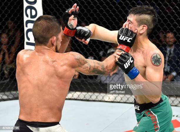 Sergio Pettis accidentally pokes Brandon Moreno of Mexico in their flyweight bout during the UFC Fight Night event at Arena Ciudad de Mexico on...