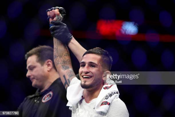 Sergio Pettis celebrates after beating Joseph Benavidez by split decision in their flyweight bout during the UFC 225: Whittaker v Romero 2 event at...