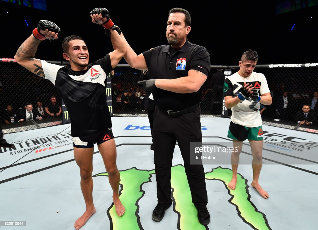 Sergio Pettis celebrates his victory over Brandon Moreno of Mexico in their flyweight bout during the UFC Fight Night event at Arena Ciudad de Mexico on August 5, 2017 in Mexico City, Mexico.