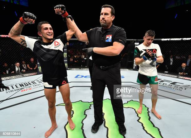 Sergio Pettis celebrates his victory over Brandon Moreno of Mexico in their flyweight bout during the UFC Fight Night event at Arena Ciudad de Mexico...