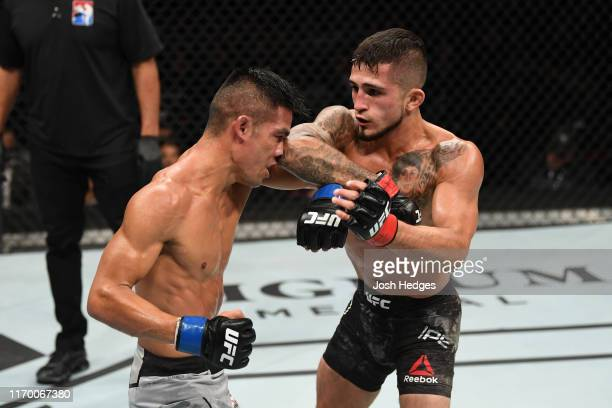 Sergio Pettis elbows Tyson Nam in their flyweight bout during the UFC Fight Night event on September 21, 2019 in Mexico City, Mexico.