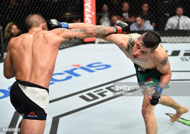 Sergio Pettis exchanges punches with Brandon Moreno of Mexico in their flyweight bout during the UFC Fight Night event at Arena Ciudad de Mexico on...
