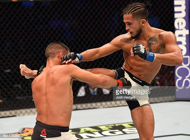 Sergio Pettis kicks Chris Cariaso in their flyweight bout during the UFC 192 event at the Toyota Center on October 3, 2015 in Houston, Texas.