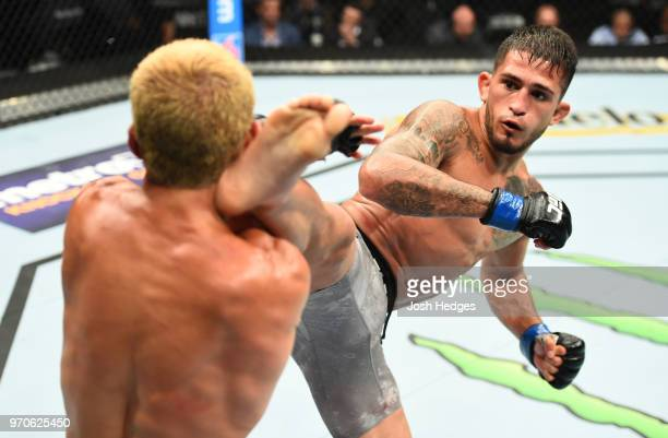 Sergio Pettis kicks Joseph Benavidez in their flyweight fight during the UFC 225 event at the United Center on June 9, 2018 in Chicago, Illinois.