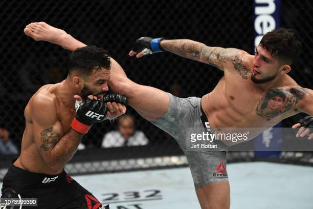 Sergio Pettis kicks Rob Font in their bantamweight bout during the UFC Fight Night event at Fiserv Forum on December 15, 2018 in Milwaukee, Wisconsin.