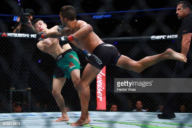 Sergio Pettis punches Brandon Moreno during the UFC Fight Night Mexico City at Arena Ciudad de Mexico on August 05 2017 in Mexico City Mexico