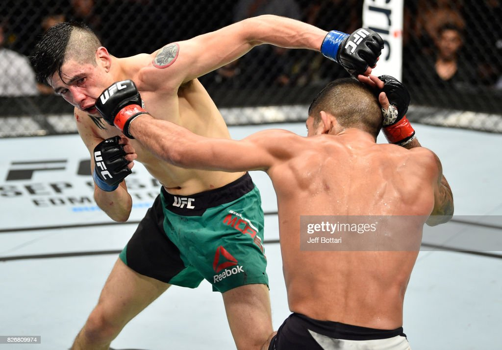 Sergio Pettis punches Brandon Moreno of Mexico in their flyweight bout during the UFC Fight Night event at Arena Ciudad de Mexico on August 5, 2017 in Mexico City, Mexico.