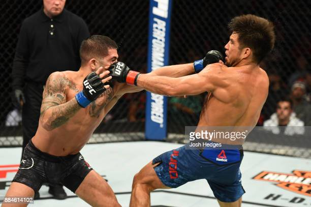 Sergio Pettis punches Henry Cejudo in their flyweight bout during the UFC 218 event inside Little Caesars Arena on December 02 2017 in Detroit...