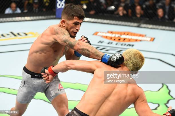 Sergio Pettis punches Joseph Benavidez in their flyweight fight during the UFC 225 event at the United Center on June 9, 2018 in Chicago, Illinois.
