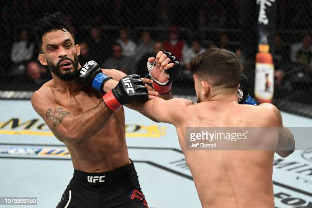 Sergio Pettis punches Rob Font in their bantamweight bout during the UFC Fight Night event at Fiserv Forum on December 15, 2018 in Milwaukee,...