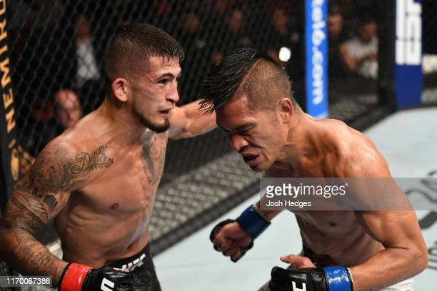 Sergio Pettis punches Tyson Nam in their flyweight bout during the UFC Fight Night event on September 21, 2019 in Mexico City, Mexico.