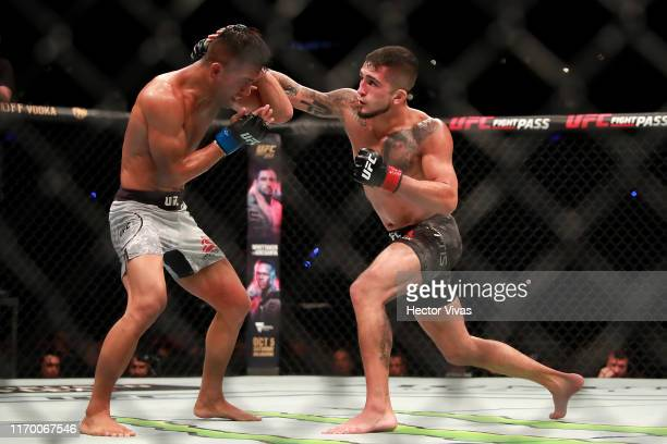 Sergio Pettis punches Tyson Nam in their flyweight bout during UFC Fight Night event at Arena Ciudad de Mexico on September 21, 2019 in Mexico City,...