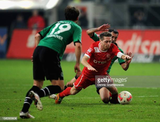 Sergio Pinto da Silva of Hannover challenges Andreas Lambertz of Duesseldorf during the Bundesliga match between Fortuna Duesseldorf 1895 and...
