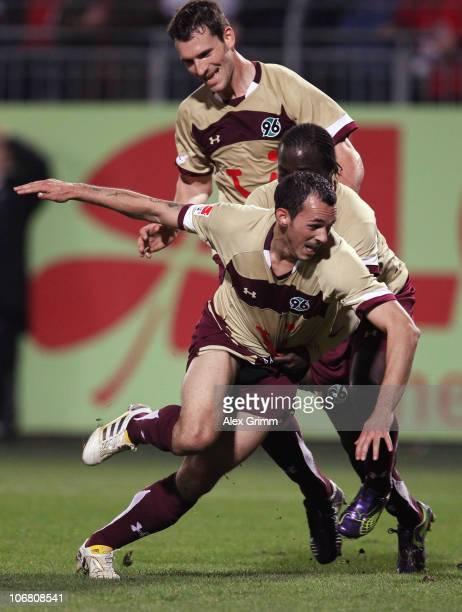 Sergio Pinto of Hannover celebrates his team's first goal with team mates Didier Ya Konan and Mario Eggimann during the Bundesliga match between FSV...