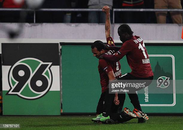 Sergio Pinto of Hannover celebrates with his team mate Didier Ya Konan after scoring his team's second goal during the UEFA Europa League Group B...