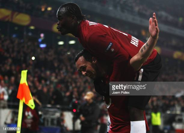 Sergio Pinto of Hannover celebrates with his team mate Didier Ya Konan after scoring his team's fourth goal during the UEFA Europa League second leg...