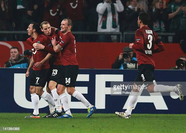 Sergio Pinto of Hannover celebrates with his team mates after scoring his team's second goal during the UEFA Europa League second leg round of 16...