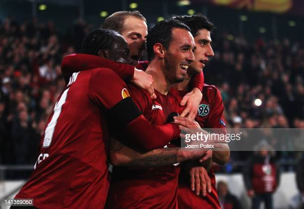 Sergio Pinto of Hannover celebrates with his team mates after scoring his team's fourth goal during the UEFA Europa League second leg round of 16...