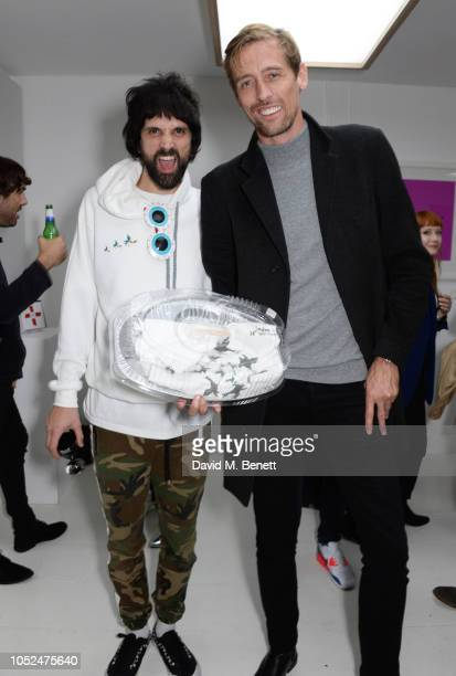 Sergio Pizzorno and Peter Crouch attend a private view of Daft Apeth by Serge Pizzorno of Kasabian at No Ho Showrooms on October 18 2018 in London...