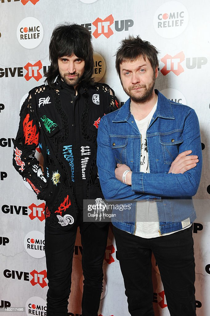 Sergio Pizzorno and Tom Meighan of Kasabian attend 'Give It Up For Comic Relief' at Wembley Arena on March 6, 2013 in London, England.