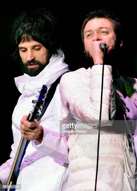 Sergio Pizzorno and Tom Meighan of Kasabian perform live on stage at Manchester Arena on November 30 2017 in Manchester England