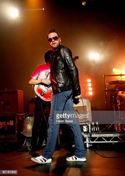 Sergio Pizzorno and Tom Meighan of Kasabian perform on stage as part of the Q Awards Gigs at The Forum on October 21 2009 in London England