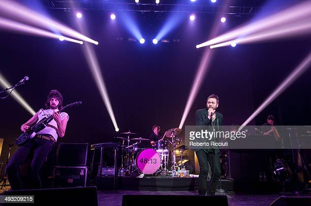 Sergio Pizzorno Ian Matthews and Tom Meighan of Kasabian perform on stage at Alhambra Theatre on May 22 2014 in Dunfermline United Kingdom