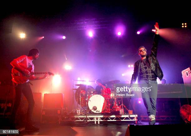 Sergio Pizzorno Ian Matthews and Tom Meighan of Kasabian perform on stage as part of the Q Awards Gigs at The Forum on October 21 2009 in London...